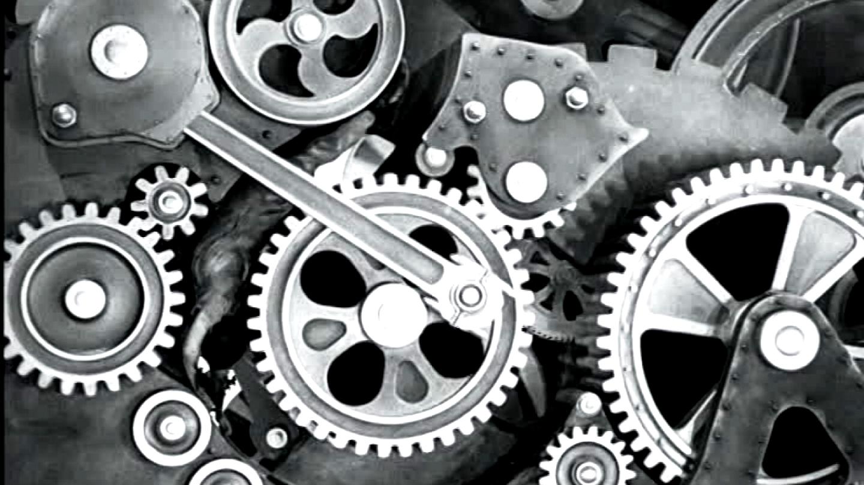 Absorption de l'ouvrier dans les rouages de la machine. Charlie Chaplindans «Les temps modernes»